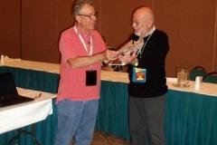 AINA President, Mel Wacks presenting David Hendin AINA's appreciation gift