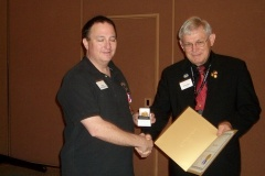 ANA Past President, Cliff Mishler, presenting Oded Paz with the 1st place medal and certificate for his Dottie Dow Exhibit